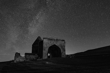Photo Stands Old building Ancient historical mausoleums complex of of the 16th century at starry night. District of Shemakhy city, Azerbaijan