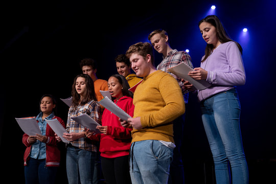Teenagers rehearsing in a theatre