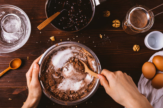 Top view female hands mix cocoa powder