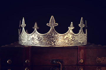 low key image of beautiful queen/king crown over wooden table. vintage filtered. fantasy medieval period Fototapete