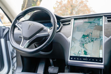 tesla digital dashboard on electric car model s steering wheel