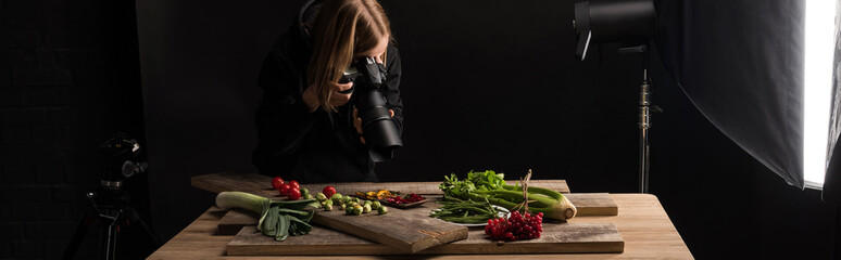 professional photographer making food composition for commercial photography and taking photo on digital camera , panoramic shot