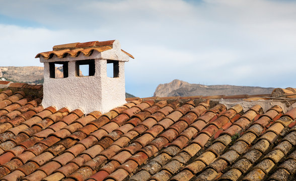 Typical Spanish roof covered in S style terracotta clay roof tiles