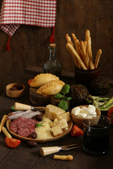 delicious snacks and antipasti on a wooden table