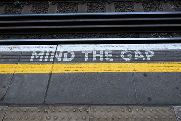"""""""Mind the gap"""" message on a railway station"""