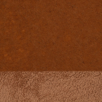 Brown textured sherpa and felt fabric material background