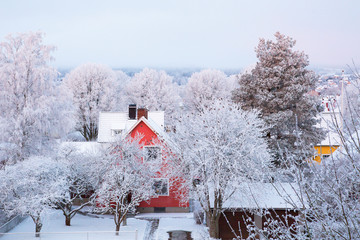 House with frost on the trees in the garden