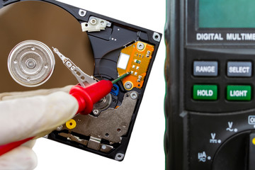 Disassembled hard drive from the computer, hdd with mirror effect. Opened hard drive from the computer hdd disk drive with mirror effects. Part of computer pc, laptop.