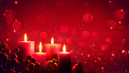 Wall Mural - Four Red Candles With Christmas Ornament In Shiny Glitter