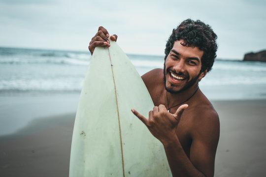 Black boy surfer on the beaches of Montañita, Ecuador