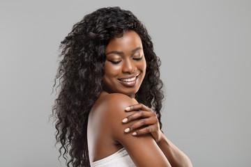 Fototapete - Beautiful afro girl touching her soft skin on body
