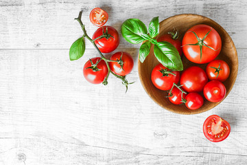 Fresh red variety tomatoes with basil on white rustic table. Tomato vegetable concept space for text or banner top view. Fototapete
