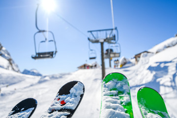 Ski lift in the dolomity mountains. Skis in the air at winter day. Cinque torri location.