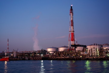 Tokyo,Japan-December 1, 2019: Night view of oil refineries viewed from a boat in Kawasaki just after the sunset