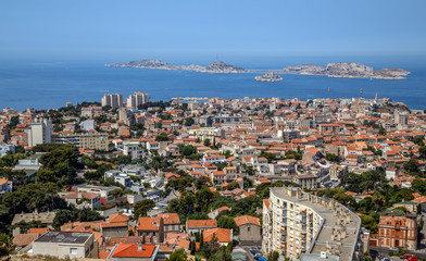 Marseille, France. Aerial panoramic view of the city, the bay and islands from the top of the hill in a summer sunny day. Holidays in France.