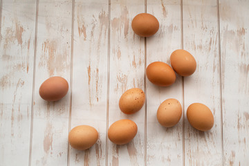 Orange eggs on weathered shabby wooden table, top view image