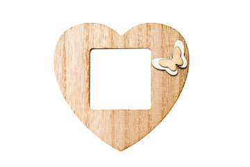 wooden photo frame in the form of a heart with free space, copy space, mock up, isolated on white background