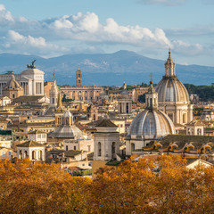 Rome skyline during autumn season, as seen from Castel Sant'Angelo, with the dome of Saint Agnes Church and the Campidoglio in background.