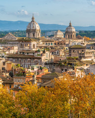Rome skyline during autumn season, as seen from Castel Sant'Angelo, with the domes of the churches of Sant'Andrea della Valle and San Carlo ai Catinari.