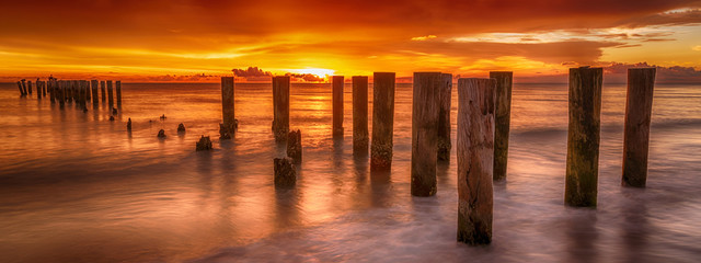 Panoramic old pier naples, Florida. Sunset at beautiful beach. Travel concept scenic coastal dream.