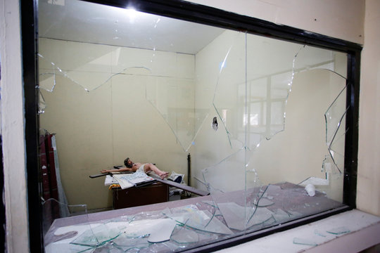 A sculpture of Jesus Christ is seen in an office of the bullet-riddled town hall of Villa Union, days after a gun battle between police and hitmen, in the municipality of Villa Union, Coahuila