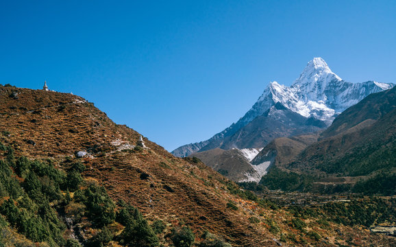 Ama Dablam 6814m peak covered with snow and ice. Imja Khola valley in  Sagarmatha National Park. Everest Base Camp (EBC) trekking route.