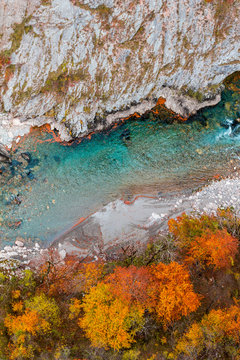 Red autumn forest and blue mountain river, rocks aerial view. Montenegro, Tara river canyon.
