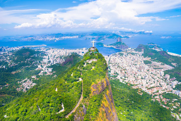 Beautiful aerial view of Rio de Janeiro city with Corcovado and Sugarloaf Mountain in the background from the helicopter ride - Rio de Janeiro, Brazil Fototapete