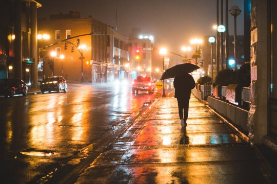 person in the rainy city at night st. johns, newfoundland, canada