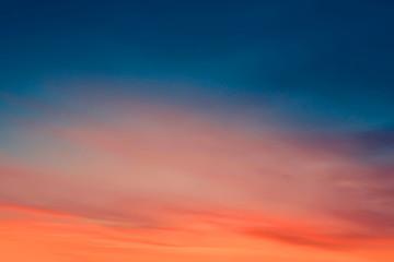 Foto op Plexiglas Ochtendgloren Brilliant orange sunset and sunrise beautiful over dark blue clouds with bright orange sun on a cool spring morning.