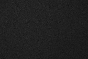 Dark black cement wall with rustic natural texture for abstract background and design purpose Fototapete