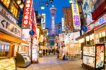 Osaka, Japan - Tsutenkaku Tower is a famous landmark of Osaka, Japan and advertises Hitachi in Shinsekai District (New World) of Naniwa Ward, Osaka City, Japan.