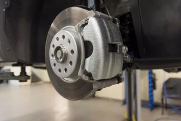 Car brake caliper close-up. Front brakes of a modern car. technical photography.