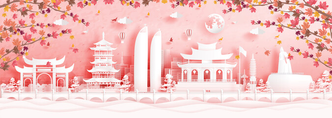 Fototapete - Autumn in Xiamen, China with falling maple leaves and world famous landmarks in paper cut style vector illustration