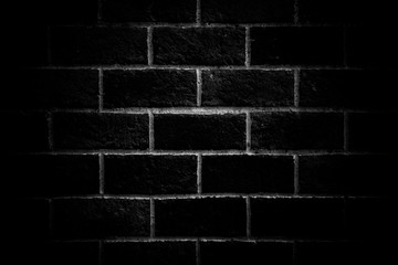 Old brick wall with vignetting of dark or black blur border gradient in bw or black and white tone...