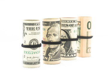 Rolls of dollars are isolated on a white background