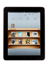 BATH, UK - NOVEMBER 8, 2011: An Apple iPad displaying the Newsstand application against a white background. Newsstand allows users to download iPad editions of newspapers and magazines.