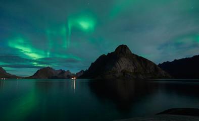 Wall Murals Green coral Aurora borealis in Norway, Reine, Lofoten Islands