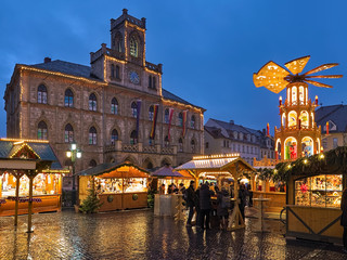 Weimar, Germany. Christmas market at Market Square in front of Town Hall in twilight.