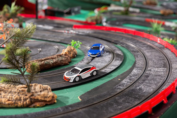 Electric slot cars on the toy race track reader to play