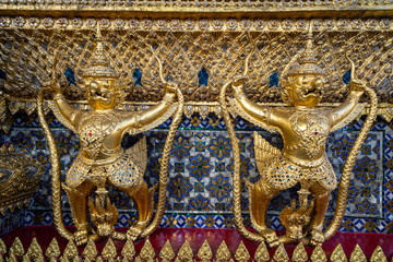 Grand Palace in Bangkok at the Wat Phra Kaew  - close up of Garuda and Nagas, at the outside of Temple of Emerald Buddah