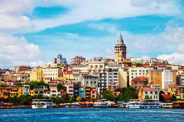 Aerial view of the Karakoy skyline with the Bosphorus. Touristic boats