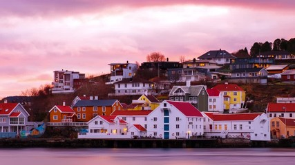 Wall Mural - Kristiansund, Norway. View of city center of Kristiansund, Norway during the cloudy morning at sunrise with colorful sky. Time-lapse of port with historical buildings, panning video