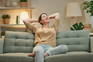woman resting on sofa