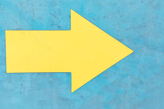 yellow arrow graphics on a blue background