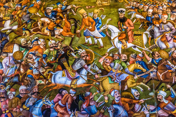 Isfahan, Iran - October 20, 2016: Details of Battle of Chaldiran painting inside the Chehel Sotoun pavilion in Isfahan city