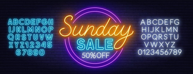 Fototapete - Sunday sale neon sign on dark background. Neon alphabet on a dark background. Template for design.
