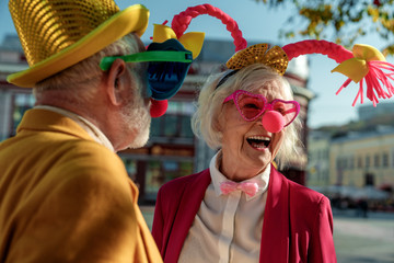 Foto op Canvas Carnaval Jolly aged woman in clown costume with husband stock photo