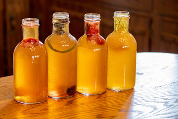 Homemade Kombucha Filling bottles with homemade kombucha and fresh fruit and herbs.