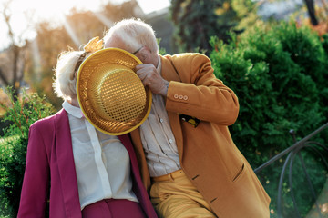 Mature lovers cuddling outdoors stock photo